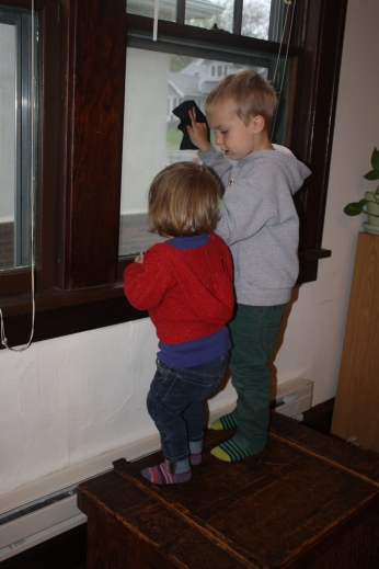 Ezra teaching Violet to clean the windows.